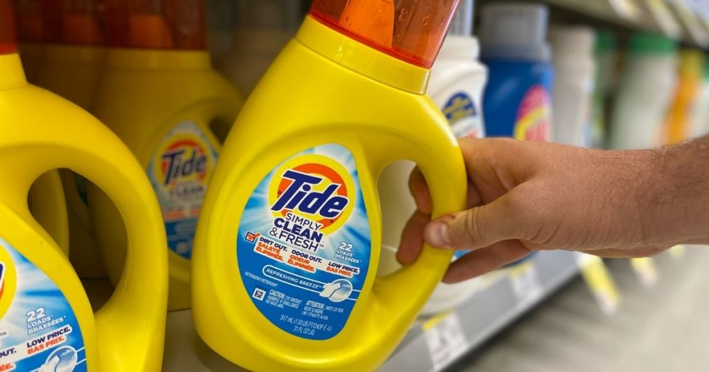 hand holding bottle of Tide Simply