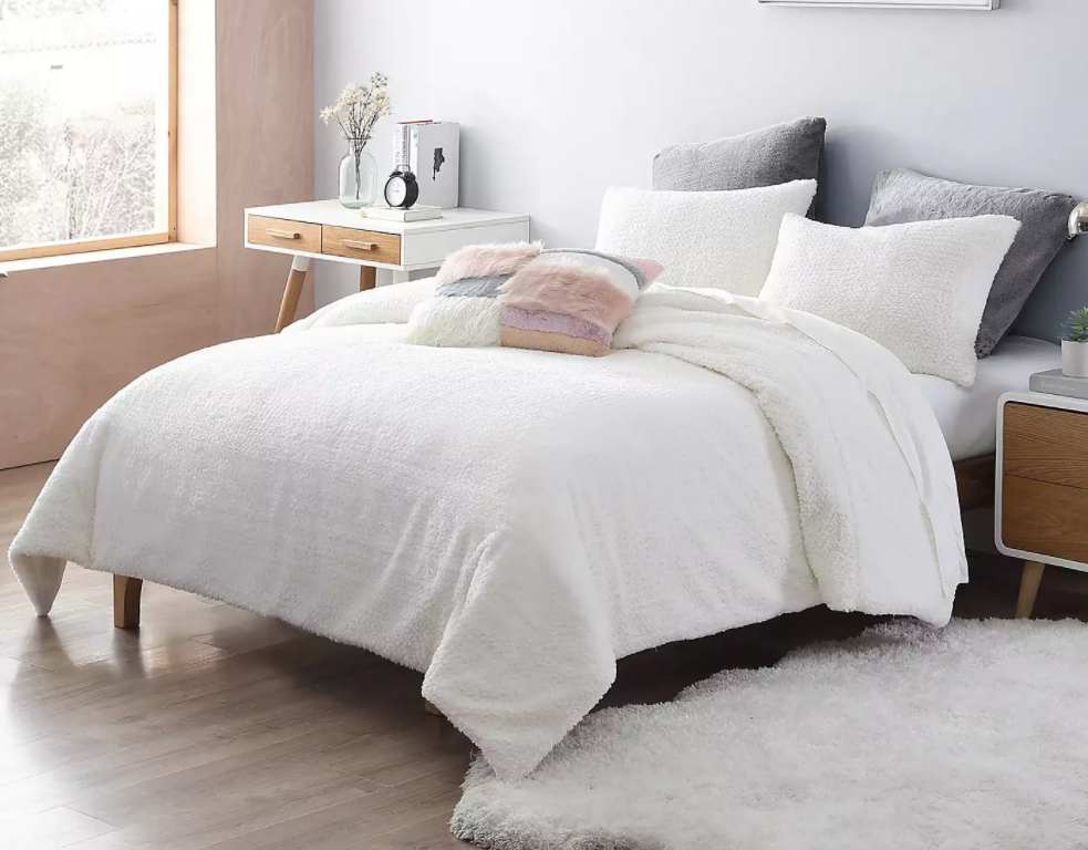 bed with a white blanket and pillows