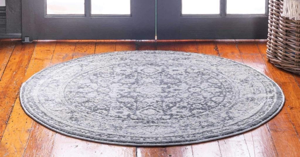 round area rug on wood floor
