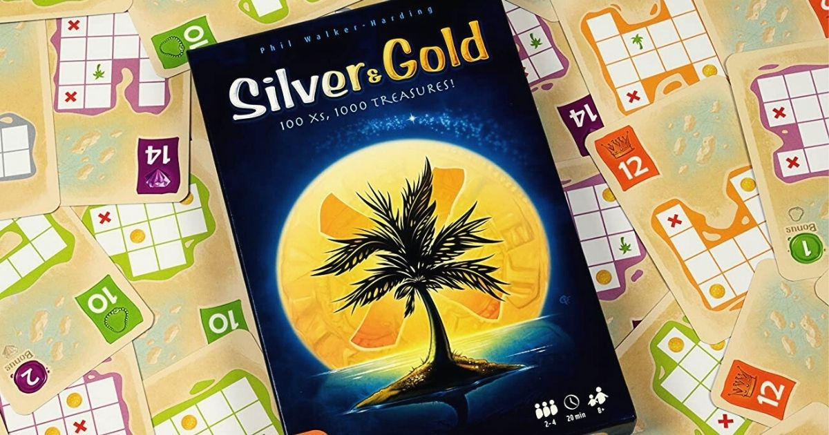 silver and gold board game in a bed of cards