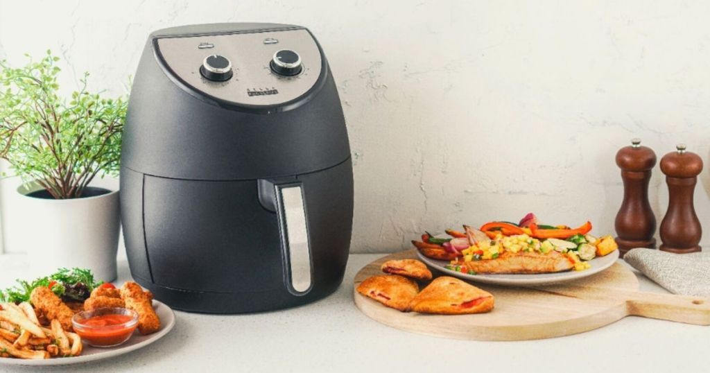 Bella pro air fryer surrounded by food