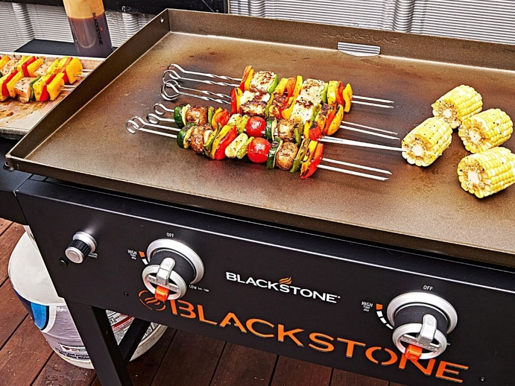 blackstone grill with food in it