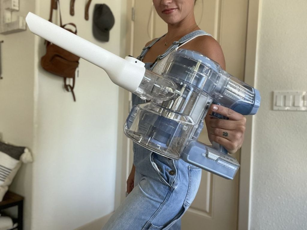 woman holding handheld vacuum