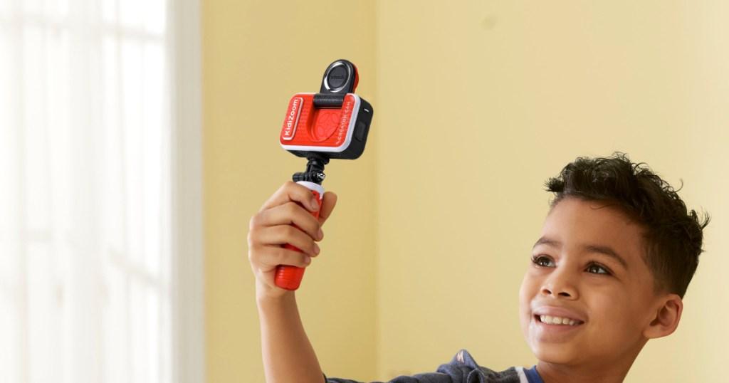 kid holding an HD camera
