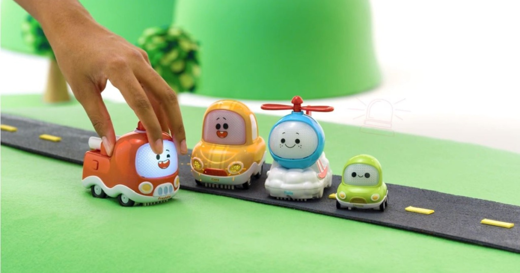 hand playing with kids play car set on track