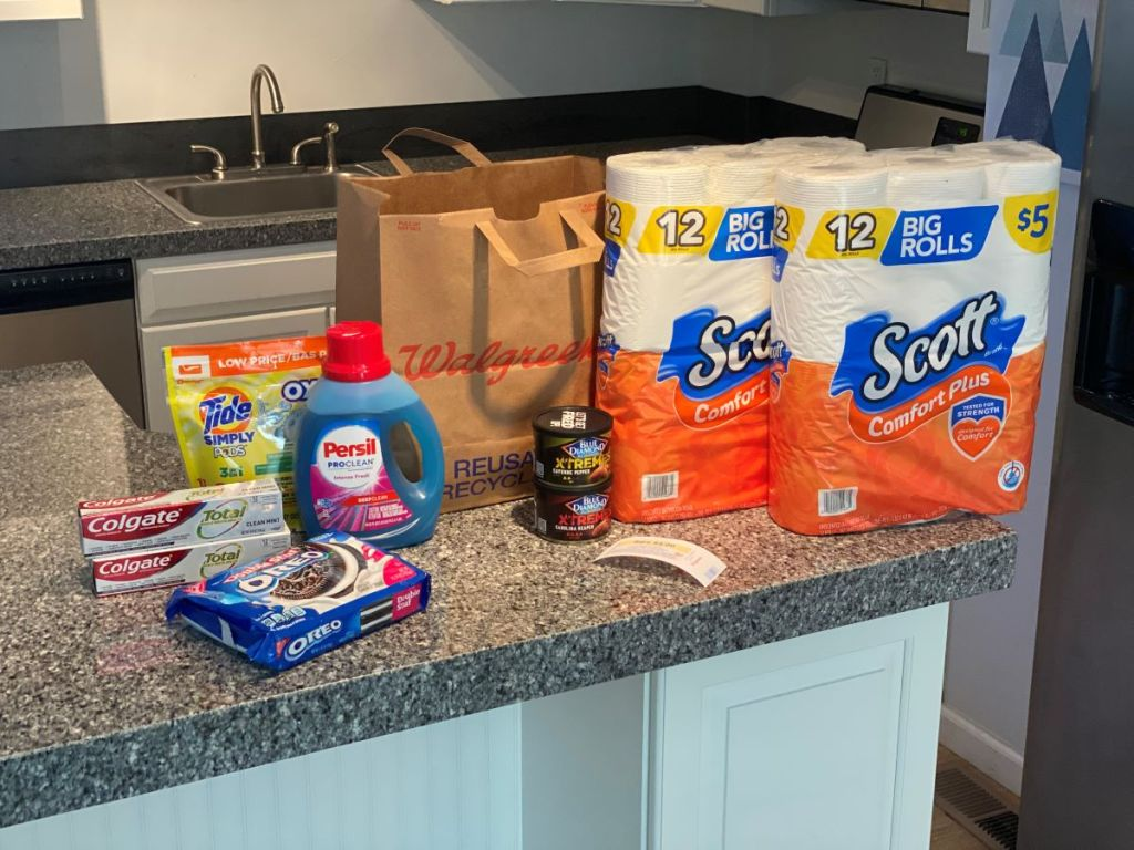 toilet paper, toothpaste, OREOs and laundry detergent on counter