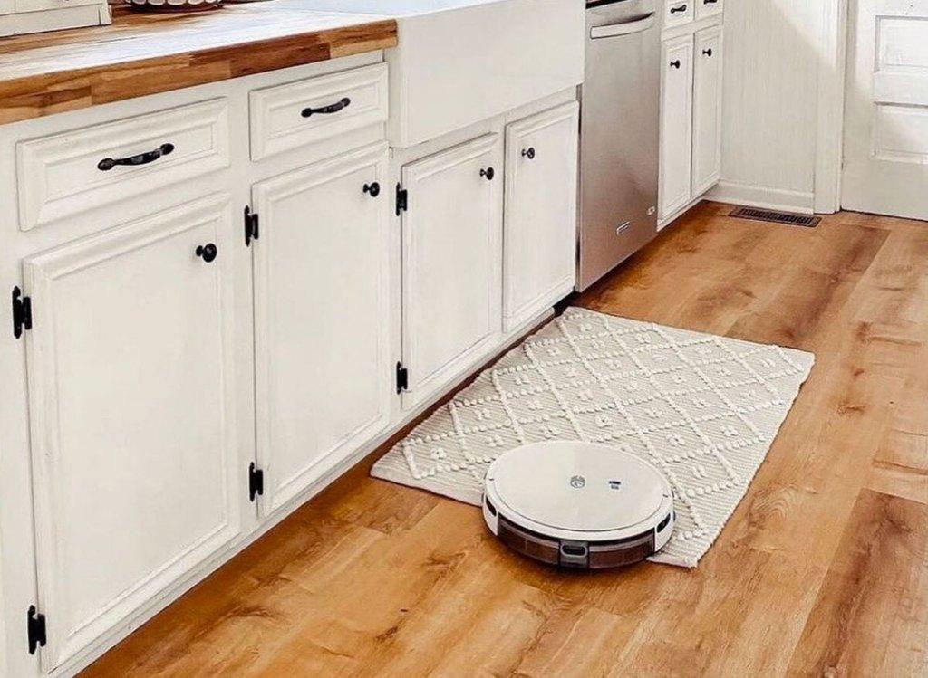 white robot vacuum in kitchen