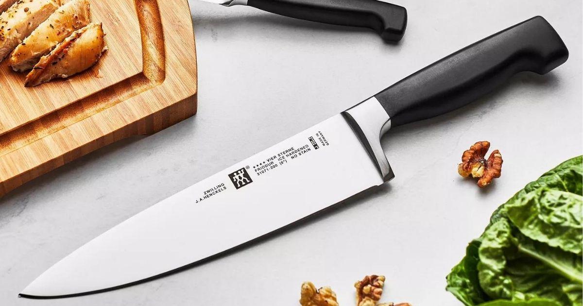 knife by a cutting board
