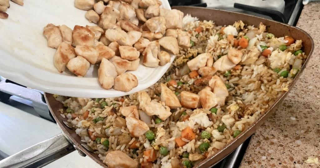 adding chicken to chicken fried rice