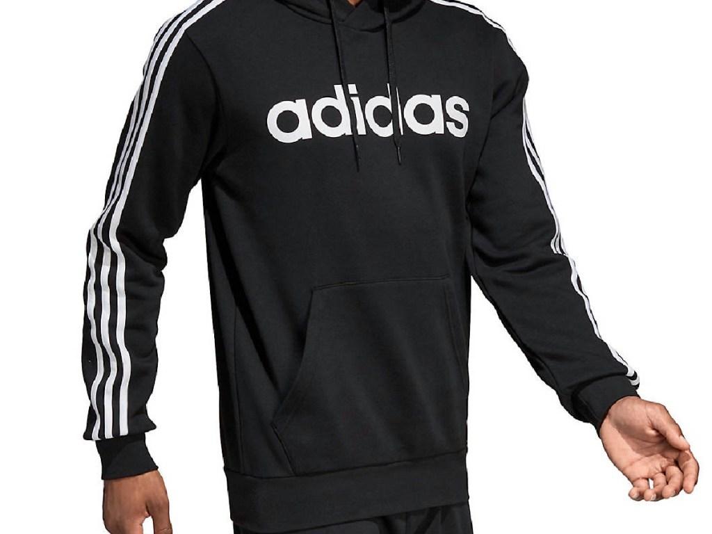 man's upper body wearing black hoodie