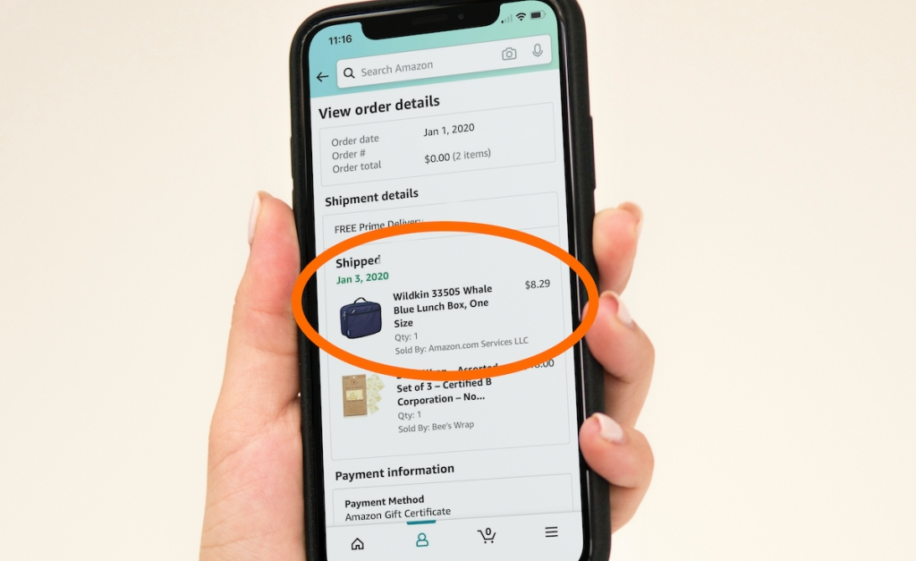 hand holding phone with amazon lunch box order on screen