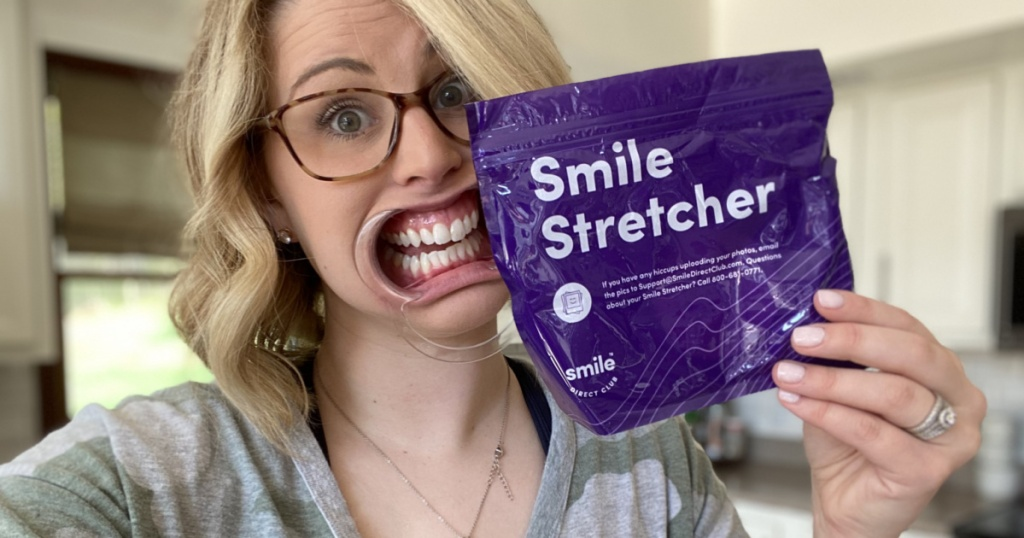 woman holding smile direct club smile stretcher