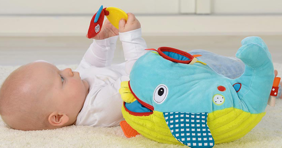 baby play with whale toy