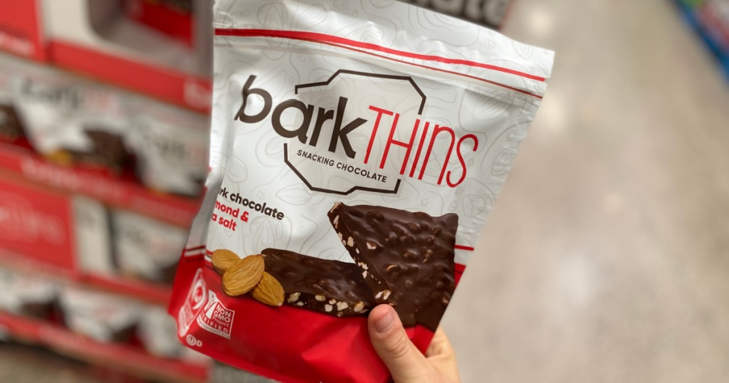 hand holding bag of snacking chocolate in store