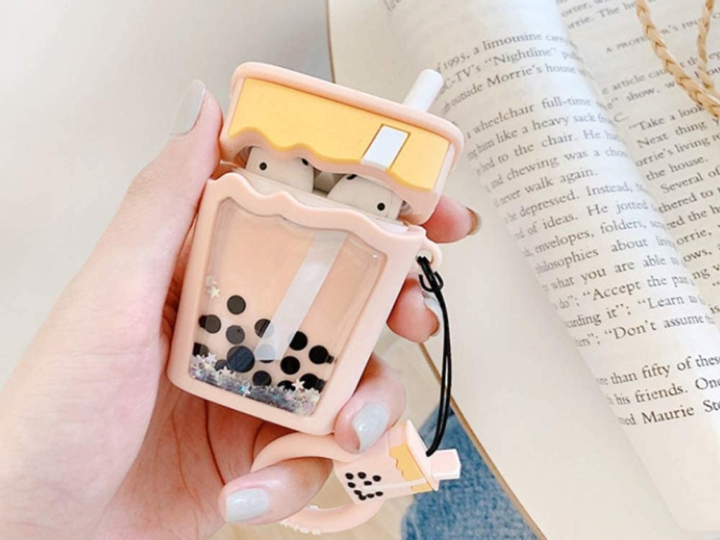 holding a cute AirPods case that looks like bubble tea