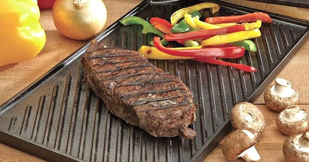 steak and veggies on cast iron grill top