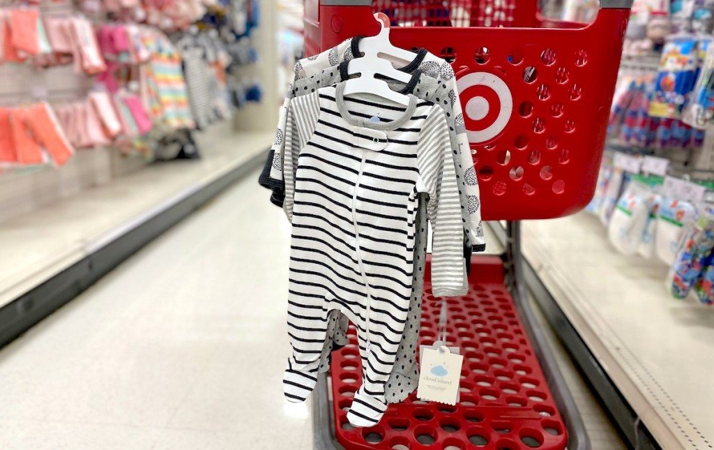 baby sleepers hanging from red target cart
