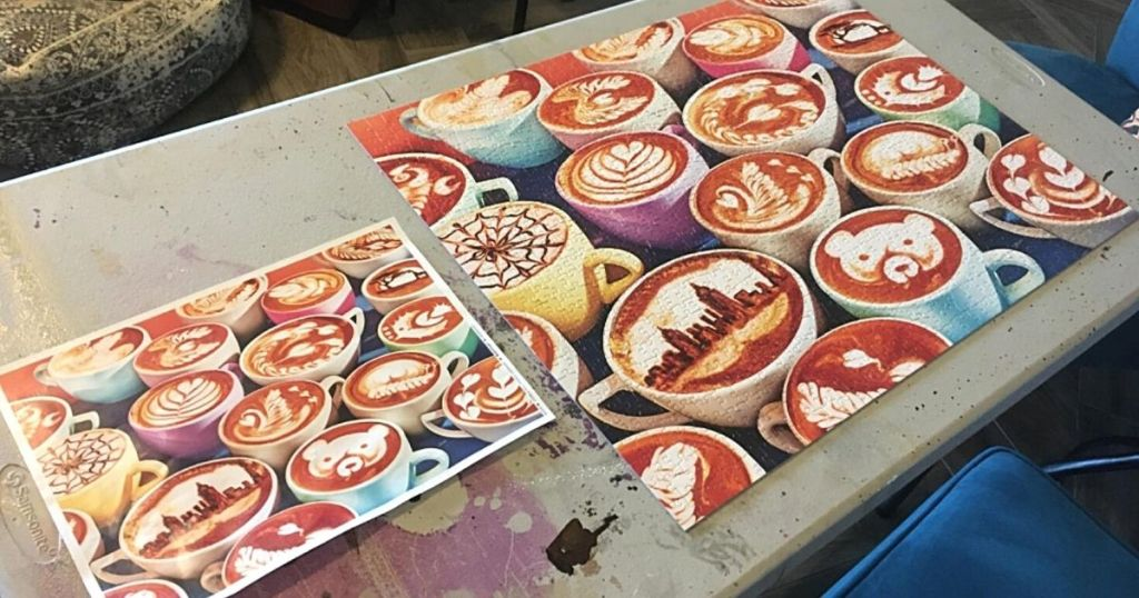 coffee cups puzzle and box on table