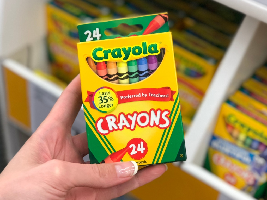 Crayola brand crayons in package in hand