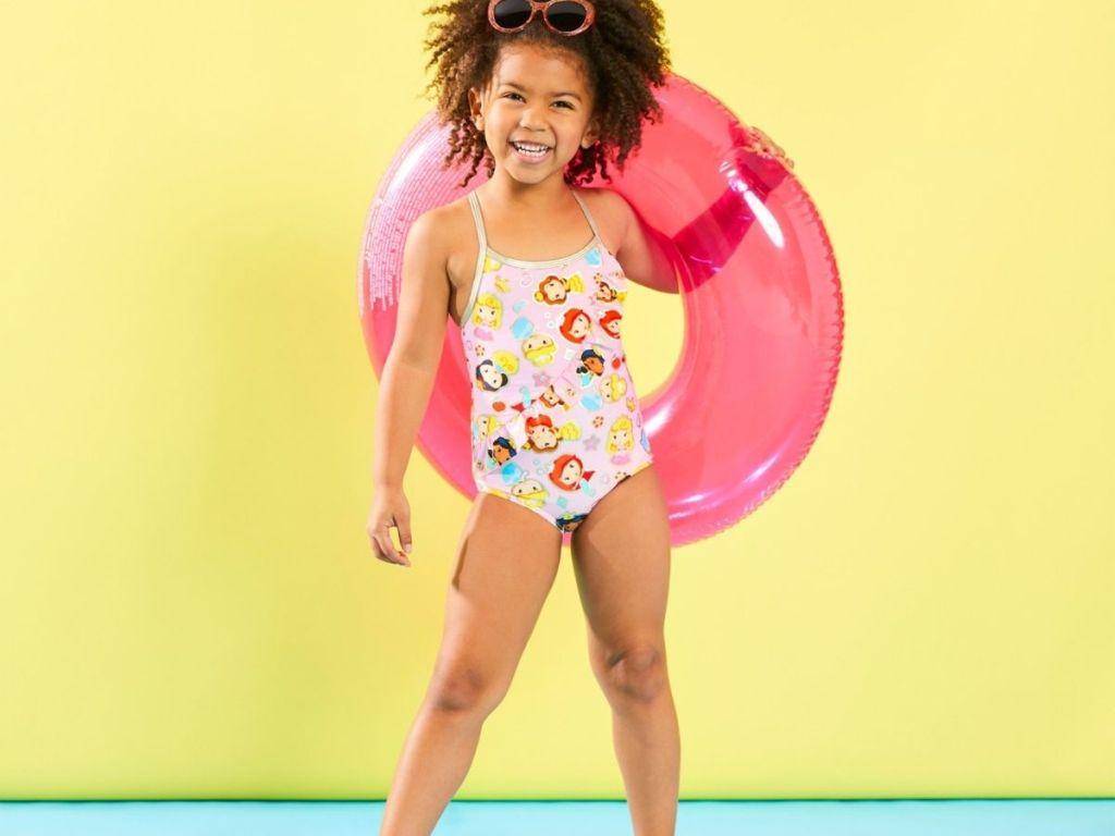 girl wearing Disney princess one-piece swimsuit