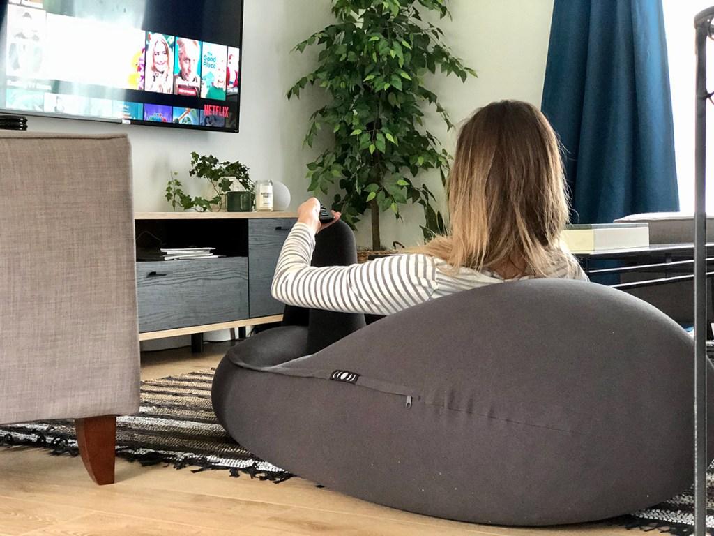 woman sitting on mood pod watching netflix