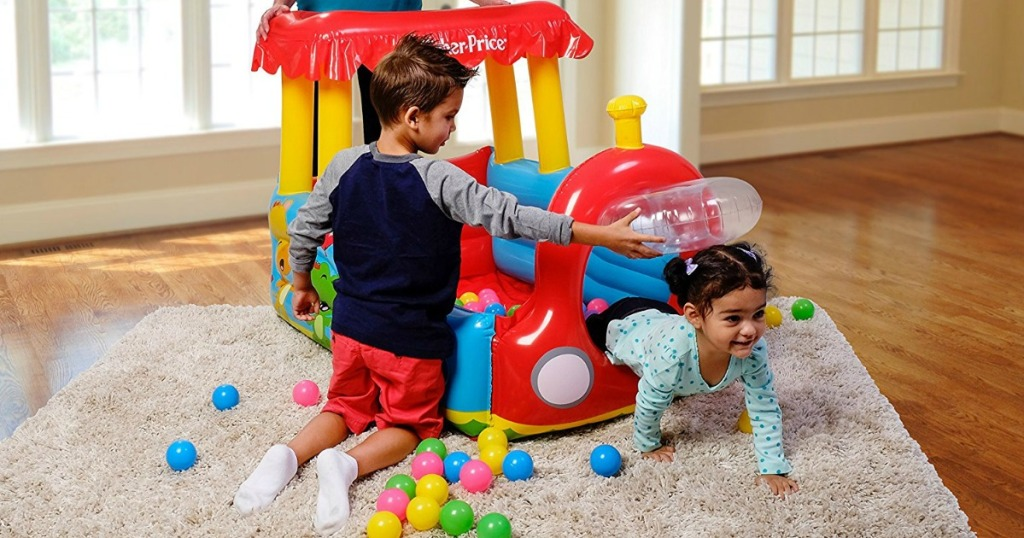 Kids playing with an inflatable train