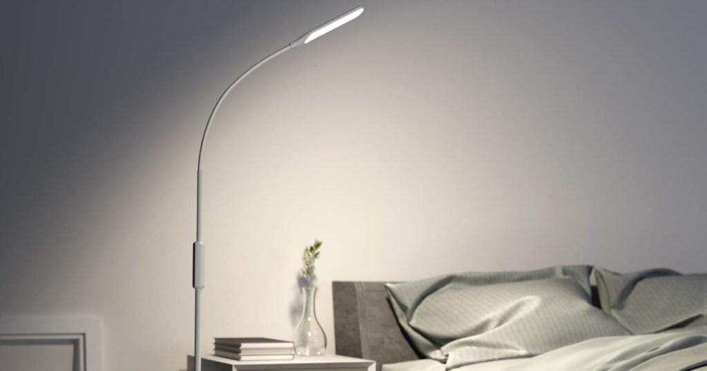 floor lamp above bed