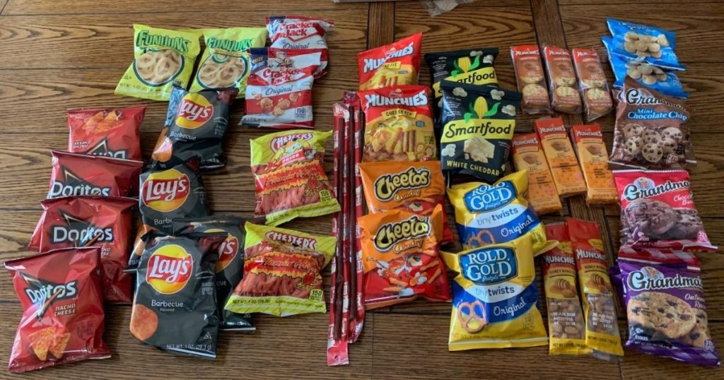 lots of frito-lay brand snacks on table