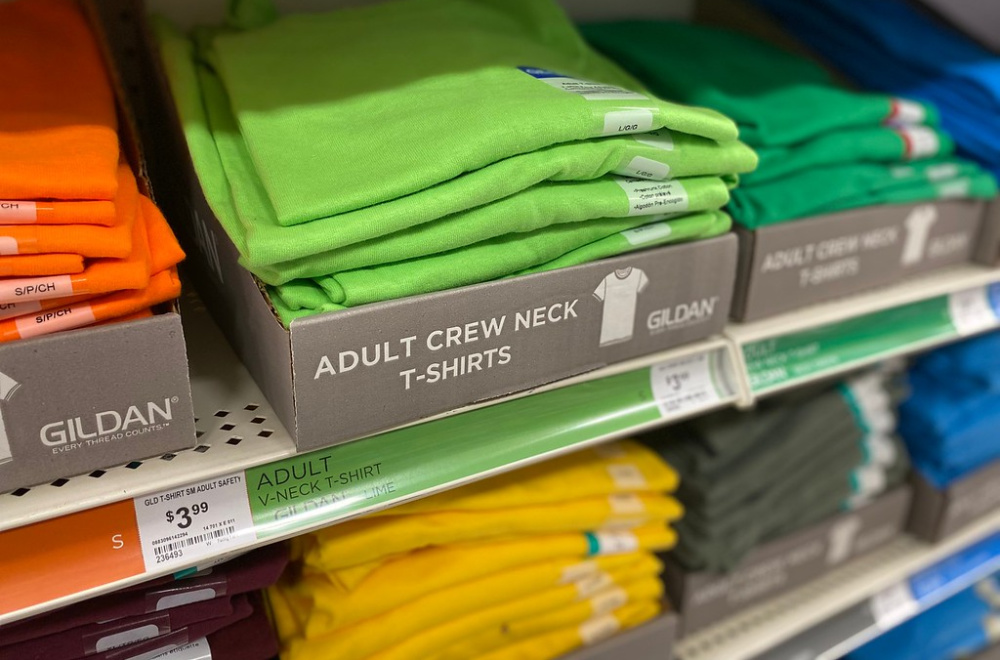 solid color tees on a store shelf display