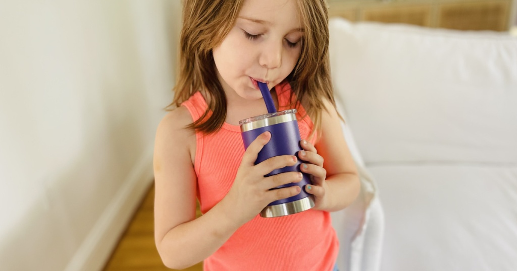girl holding houssavy cup
