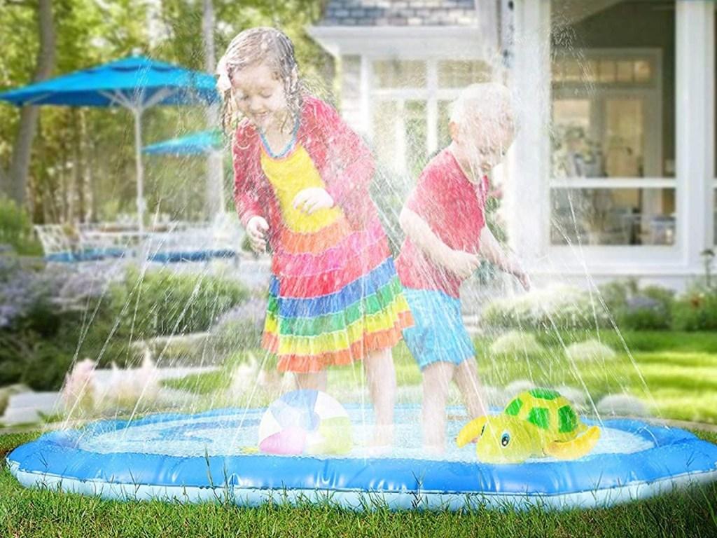 kids playing on a splash pad