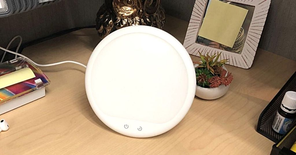 round light therapy lamp on desk