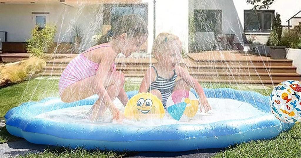 boy and girl playing on a splash pad