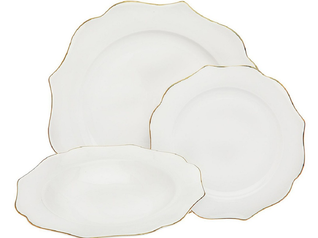 set of white dinnerware lined in gold
