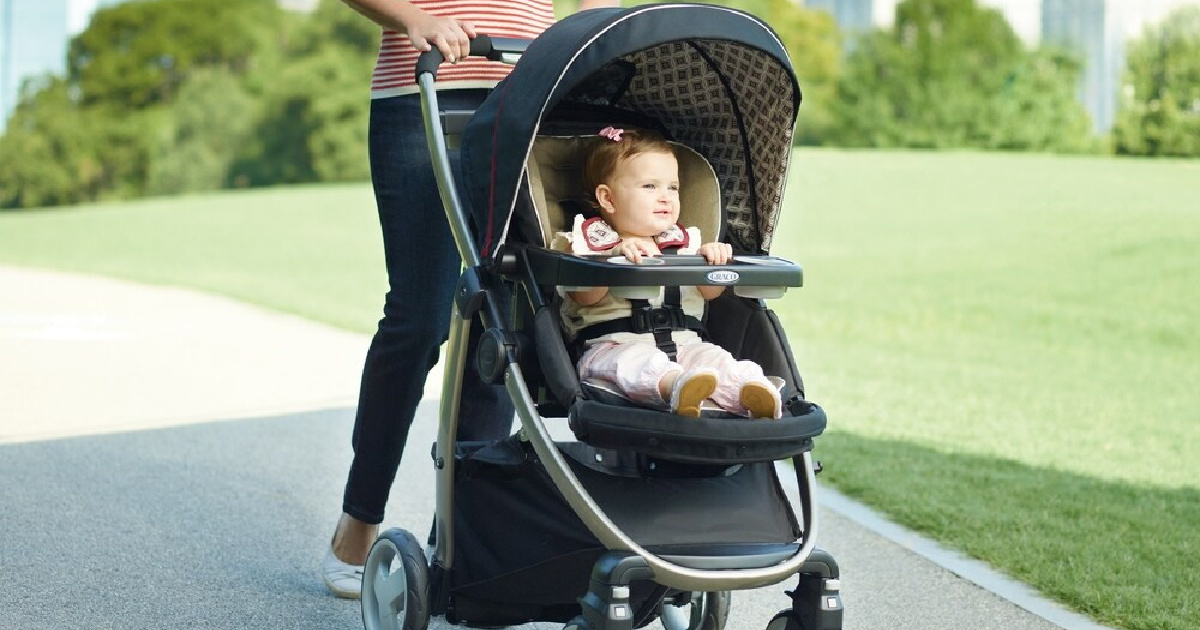 woman pushing a baby in a stroller outside