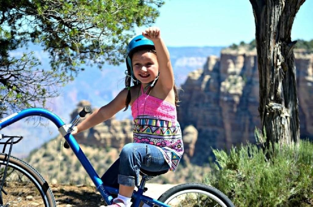 girl riding bike in grand canyon
