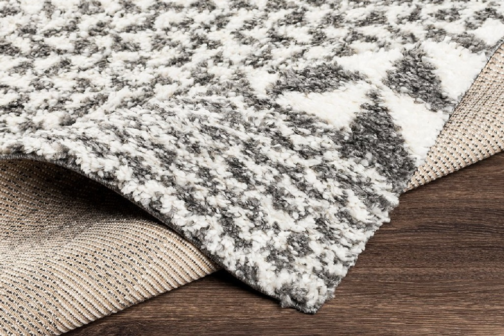 gray and white triangle boho rug
