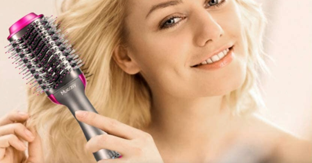 woman using hair dryer: styler