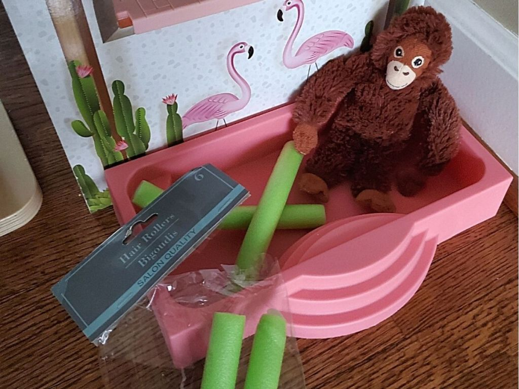toy plush monkey using pool noodles in toy pool