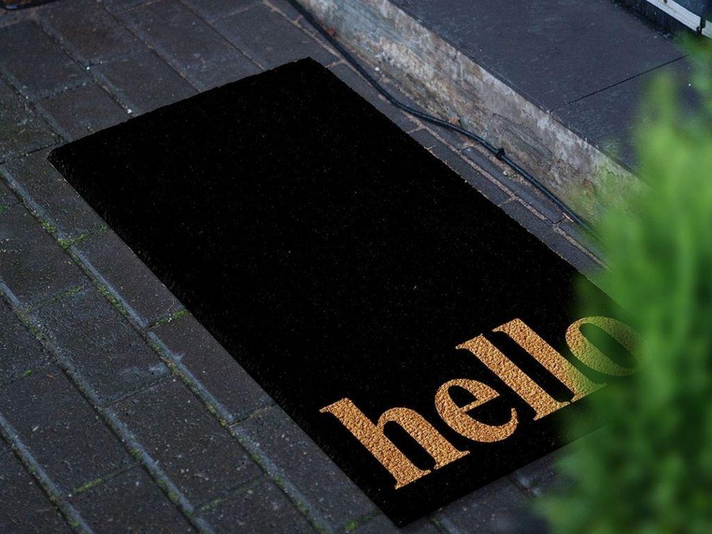 black and gold hello doormat