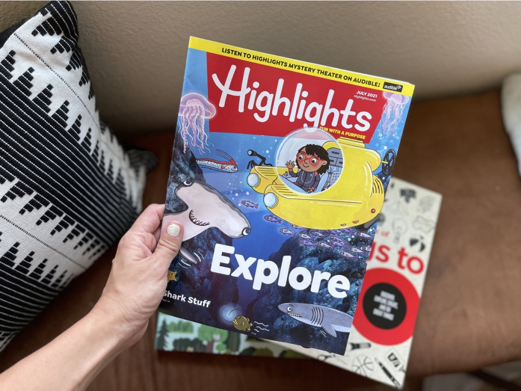 highlights magazine subscription in hand