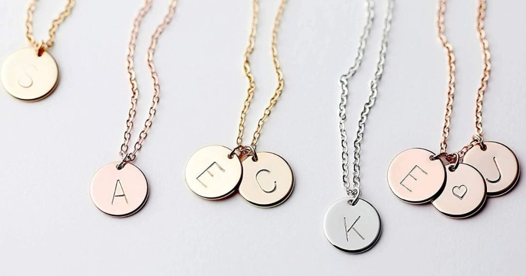 many dangling initial stamped necklace charms