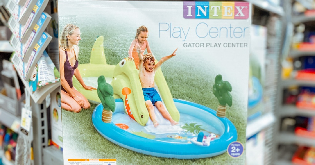 box with an inflatable kids play pool with gator slide