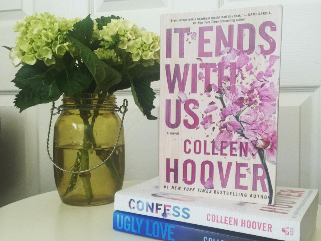 Colleen Hoover books next to flower vase