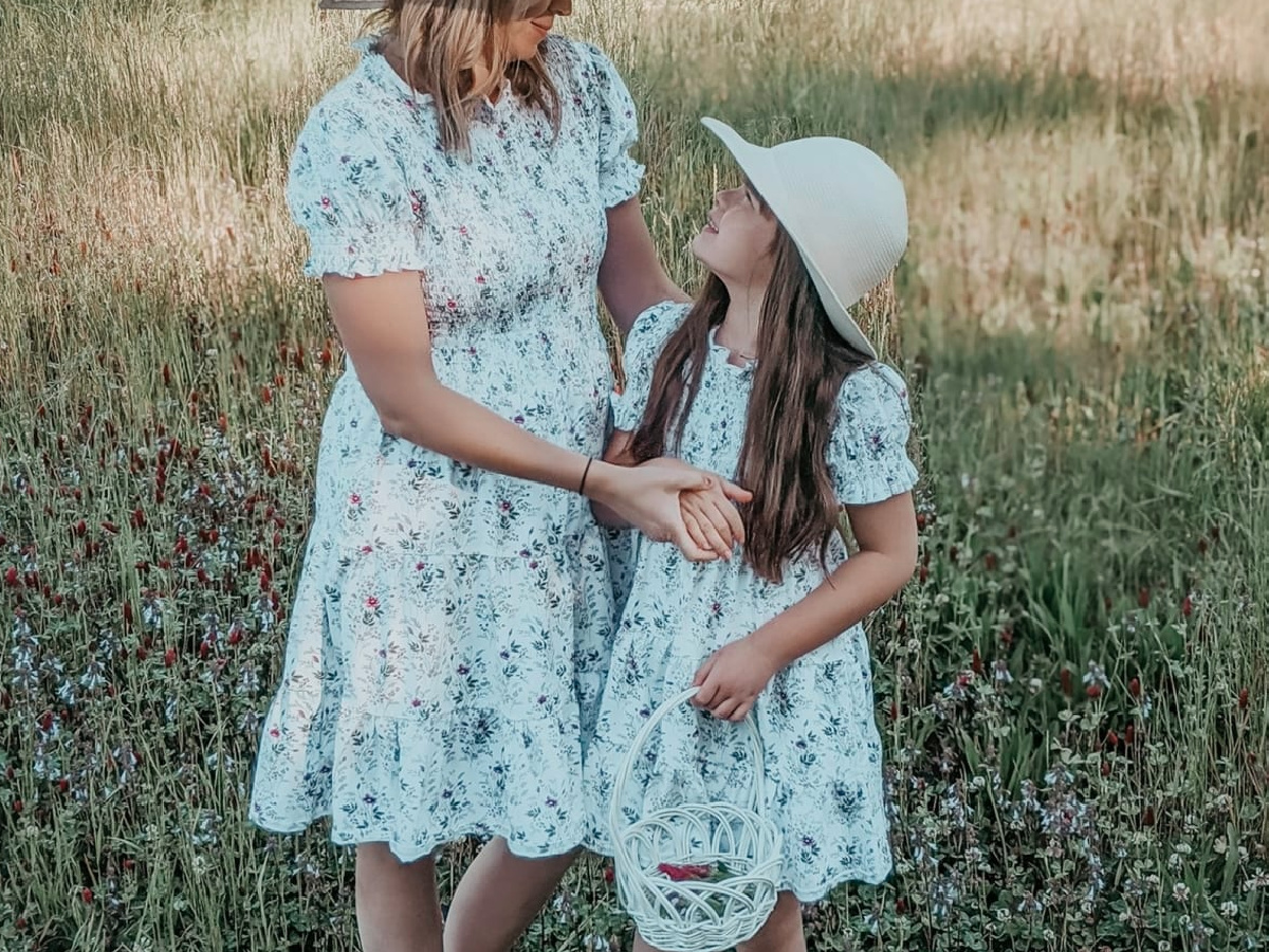 woman and daughter wearing flowery dresses