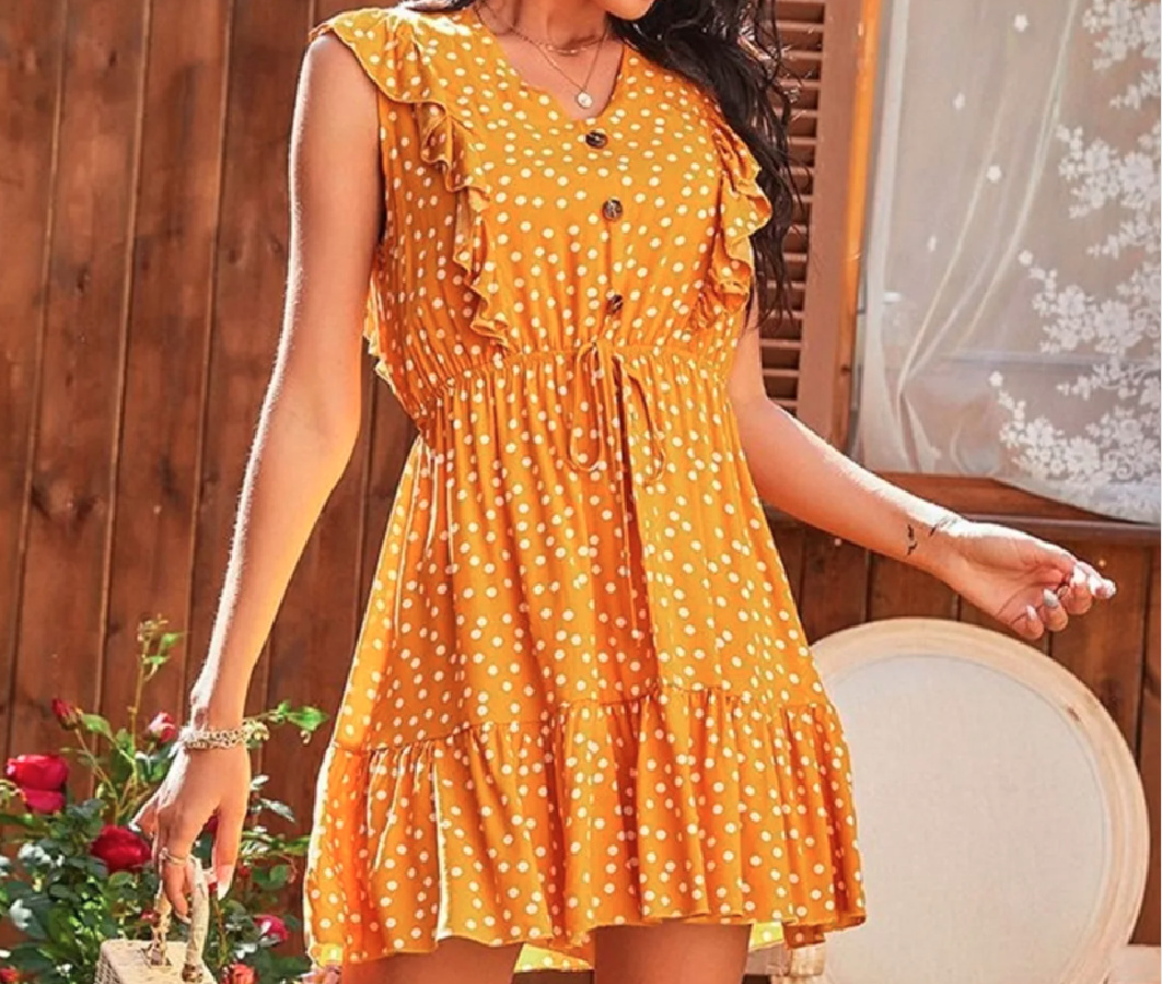woman wearing orange and white polka dot dress with front buttons