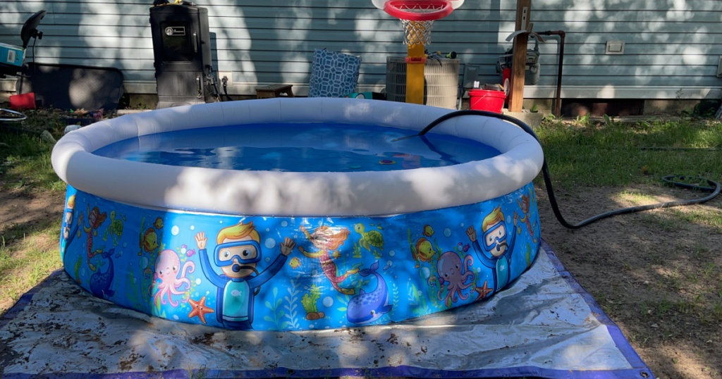 colorful inflatable pool in backyard