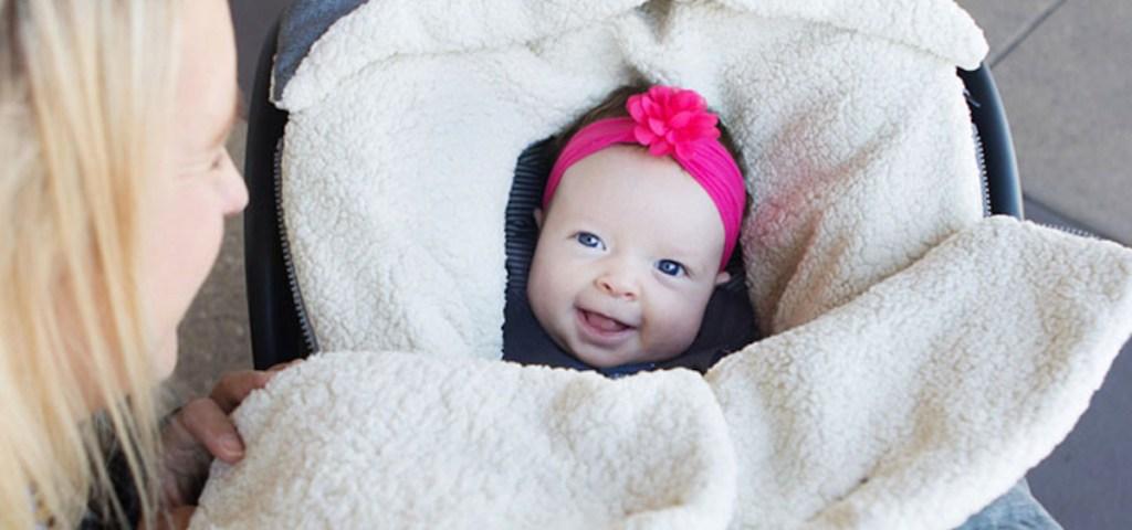 baby girl wearing pink headband smiling