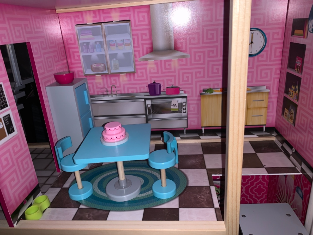 room in dollhouse with cake and kitchen table