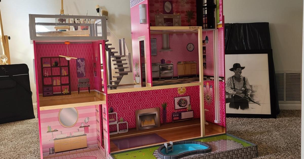 large pink dollhouse in livingroom